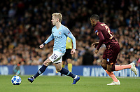 Manchester City's Oleksandr Zinchenko threads a pass despite the attentions of 1899 Hoffenheim's Joshua Brenet<br /> <br /> Photographer Rich Linley/CameraSport<br /> <br /> UEFA Champions League Group F - Manchester City v TSG 1899 Hoffenheim - Wednesday 12th December 2018 - The Etihad - Manchester<br />  <br /> World Copyright © 2018 CameraSport. All rights reserved. 43 Linden Ave. Countesthorpe. Leicester. England. LE8 5PG - Tel: +44 (0) 116 277 4147 - admin@camerasport.com - www.camerasport.com