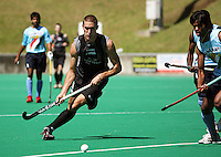 NZ's Joel Baker on attack during the international hockey match between the New Zealand Black Sticks and India at National Hockey Stadium, Wellington, New Zealand on Saturday, 20 February 2009. Photo: Dave Lintott / lintottphoto.co.nz