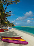 Canoes on lagoon at resort in Aitutaki, Cook Islands