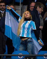 Argentina supporter with signed shirt & flag during the International Friendly match between Argentina and Italy at the Etihad Stadium, Manchester, England on 23 March 2018. Photo by Andy Rowland.