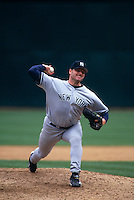 OAKLAND, CA - Roger Clemens of the New York Yankees pitches during a game against the Oakland Athletics at the Oakland Coliseum in Oakland, California in 1999. Photo by Brad Mangin