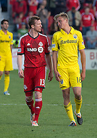 18 May 2013: Toronto FC defender Steven Caldwell #13 talks with Columbus Crew forward Aaron Schoenfeld #18 during an MLS game between the Columbus Crew and Toronto FC at BMO Field in Toronto, Ontario Canada..The Columbus Crew won 1-0...