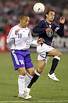 10 February 2006: Japan's Shinji Ono (18) heads the ball away from US midfielder Landon Donovan (right). The United States Men's National Team defeated Japan 3-2 at SBC Park in San Francisco, California in an International Friendly soccer match.
