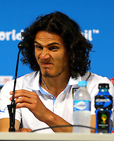 Edison Cavani of Uruguay pulls a face as he talks in the press conference ahead of tomorrow's Group D match vs England