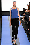 Sara walks runway in a cyan blue crepe shell with back banded strap, and carbon black stretch wool pant with sequin yolk, by Monique Lhuillier, from the Monique Lhuillier Spring 2012 collection fashion show, during Mercedes-Benz Fashion Week Spring 2012.