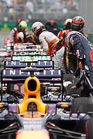 Drivers inspect their cars after their qualifying session on day four of the 2013 Formula One Rolex Australian Grand Prix at the Albert Park Circuit in Melbourne, Australia.