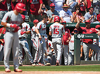 NWA Democrat-Gazette/CHARLIE KAIJO Arkansas infielder Casey Martin (15) returns to the dugout after a score during the second game of the NCAA super regional baseball, Sunday, June 10, 2018 at Baum Stadium in Fayetteville. Arkansas fell to South Carolina 5-8.