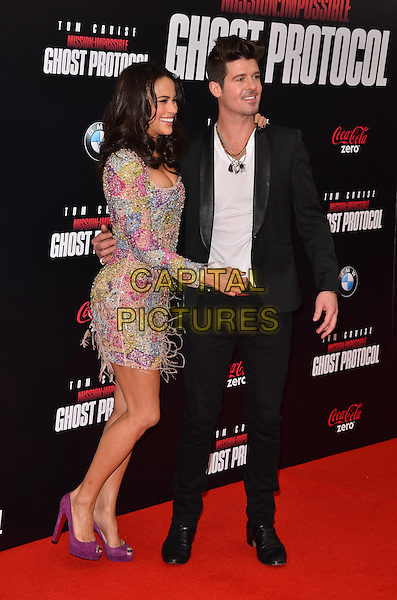 "Paula Patton & Robin Thicke.""Mission: Impossible - Ghost Protocol"" New York Premiere, New York City, NY, USA..December 19th, 2011.full length purple pink shoes yellow blue dress feathers beads beaded side profile couple black suit white shirt .CAP/ADM/CS.©Christopher Smith/AdMedia/Capital Pictures."