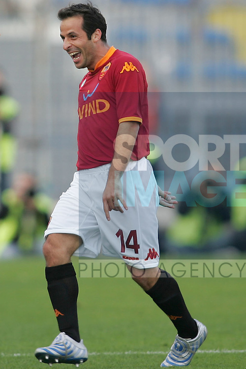 Ludovic Giuly of Roma celebrates scoring a goal
