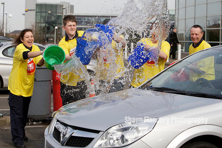 Pix: Shaun Flannery/shaunflanneryphotography.com...COPYRIGHT PICTURE>>SHAUN FLANNERY>01302-570814>>07778315553>>..19th March 2010..........Sport Relief event at the BT Call Centre, Wilmington Drive, Doncaster..Car Wash L-R Sue Hardaker, Richard Tabern, Dee Singh, Cheryl Gravil, Tony Turycha.