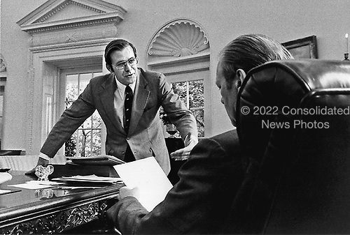 United States President Gerald R. Ford and Chief of Staff Donald Rumsfeld work in the Oval Office in the White House in Washington, D.C. on September 29, 1974. <br /> Mandatory Credit: David Hume Kennerly / White House via CNP