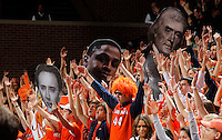 Virginia fans hold up signs during the game Sunday in Charlottesville, VA. Virginia defeated Maryland in overtime 61-58. Photo/Andrew Shurtleff