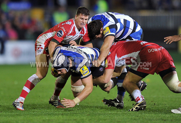 Dave Attwood is tackled to ground. Aviva Premiership match, between Bath Rugby and Gloucester Rugby on October 25, 2013 at the Recreation Ground in Bath, England. Photo by: Patrick Khachfe / Onside Images