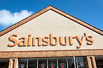 Close up of Sainsbury's supermarket store sign, Chippenham, Wiltshire, England, UK