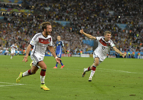 13.07.2014. Estadio do Maracana Rio de Janeiro, Brazil. Scorer Mario Goetze (Ger) with Thomas Muller (Ger) after scoring the winning goal for 1-0 during extra time at the FIFA World Cup 2014 final soccer match between Germany and Argentina at the Estadio do Maracana in Rio de Janeiro, Brazil, 13 July 2014.