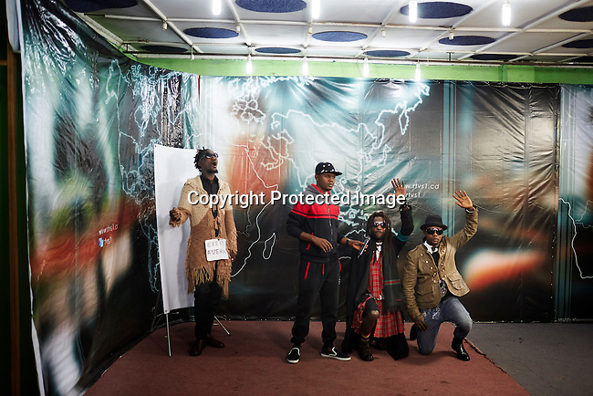 "KINSHASA, DEMOCRATIC REPUBLIC OF CONGO - July 16: Sapeurs from the group Leopard de la Sape visit a studio for a live television show on July 16, 2014, in Kinshasa, DRC. The word Sapeur comes from SAPE, a French acronym for Société des Ambianceurs et Persons Élégants or Society of Revellers and Elegant People and it also means, to dress with elegance and style"". Most of the young Sapeurs are unemployed, poor and live in harsh conditions in Kinshasa, a city of about 10 million people. For many of them being a Sapeur means they can escape their daily struggles and dress like fashionable Europeans. Many hustle to build up their expensive collections. Most Sapeurs could never afford to visit Paris, and usually relatives send or bring clothes back to Kinshasa. (Photo by Per-Anders Pettersson)"