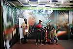 """KINSHASA, DEMOCRATIC REPUBLIC OF CONGO - July 16: Sapeurs from the group Leopard de la Sape visit a studio for a live television show on July 16, 2014, in Kinshasa, DRC. The word Sapeur comes from SAPE, a French acronym for Société des Ambianceurs et Persons Élégants or Society of Revellers and Elegant People and it also means, to dress with elegance and style"""". Most of the young Sapeurs are unemployed, poor and live in harsh conditions in Kinshasa, a city of about 10 million people. For many of them being a Sapeur means they can escape their daily struggles and dress like fashionable Europeans. Many hustle to build up their expensive collections. Most Sapeurs could never afford to visit Paris, and usually relatives send or bring clothes back to Kinshasa. (Photo by Per-Anders Pettersson)"""