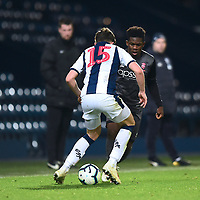 Lincoln City U18's Timothy Akinola vies for possession with  West Bromwich Albion U18's Zak Delaney<br /> <br /> Photographer Andrew Vaughan/CameraSport<br /> <br /> FA Youth Cup Round Three - West Bromwich Albion U18 v Lincoln City U18 - Tuesday 11th December 2018 - The Hawthorns - West Bromwich<br />  <br /> World Copyright &copy; 2018 CameraSport. All rights reserved. 43 Linden Ave. Countesthorpe. Leicester. England. LE8 5PG - Tel: +44 (0) 116 277 4147 - admin@camerasport.com - www.camerasport.com