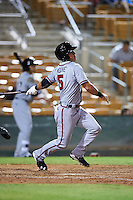 Salt River Rafters Dylan Moore (5), of the Atlanta Braves organization, hits a home run during a game against the Glendale Desert Dogs on October 19, 2016 at Camelback Ranch in Glendale, Arizona.  Salt River defeated Glendale 4-2.  (Mike Janes/Four Seam Images)