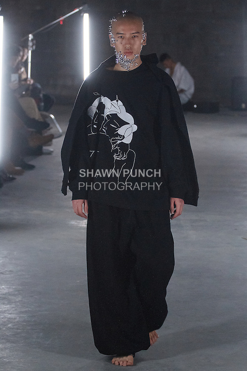 Model walks runway in an outfit from the Ikumi Fall Winter 2016 collection, at 433 Broadway on February 12, 2016, during New York Fashion Week Fall 2016.