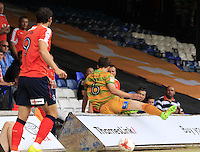 Yeovil Town defender Alex Lacey takes a tumble over the advertising boards during the Sky Bet League 2 match between Luton Town and Yeovil Town at Kenilworth Road, Luton, England on 13 August 2016. Photo by Liam Smith.
