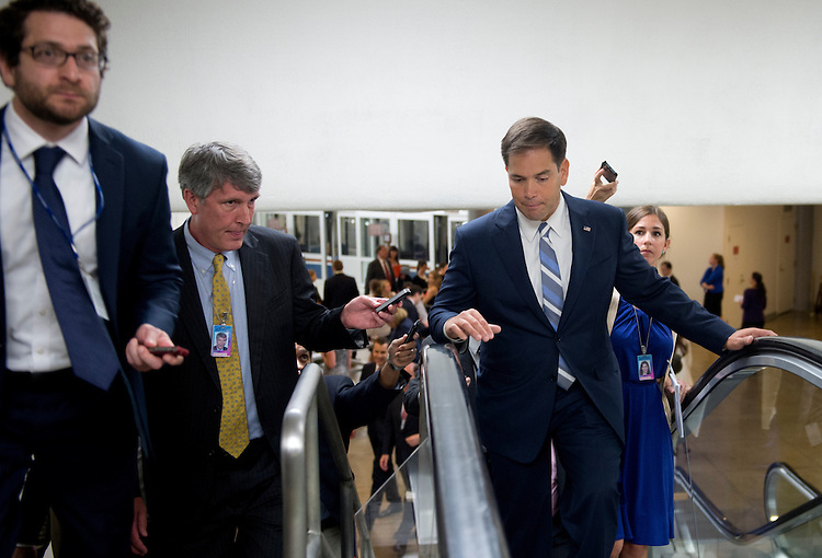 UNITED STATES - June 18: Sen. Marco Rubio, R-Fl., walks to the U.S. Capitol to attend the Senate luncheons via way of the Senate subway on June 18, 2013. (Photo By Douglas Graham/CQ Roll Call)