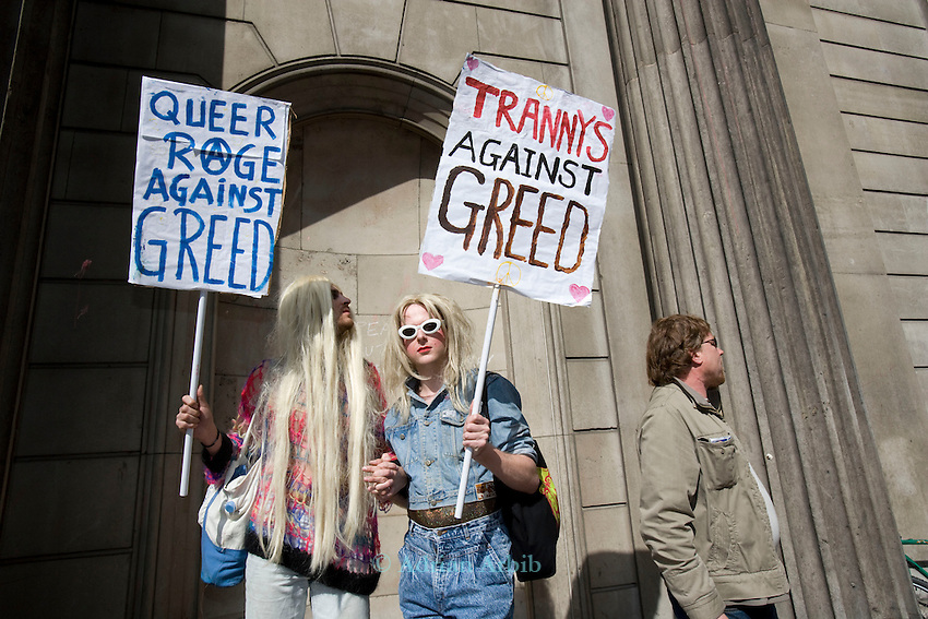 2 gay activists and their placards. <br /> Thousands of protesters marched on the Bank of England in city of London during the G20 conference meeting  in London April 2009 , RBS  Bank windows were smashed on the ground floor. Police made around 90 arrests.