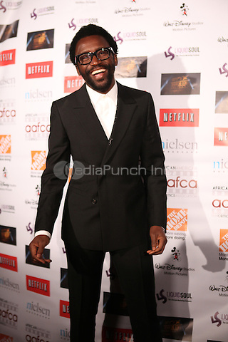 LOS ANGELES, CALIFORNIA - JANUARY 31: Tony Okungbowa at the African American Film Critics Association 5th Annual Awards Dinner on Friday Jan 31st, 2014  at the Taglyan Cultural Complex in Los Angeles, California. Photo Credit: RTNjohnson/MediaPunch.