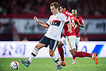 (L) Mario Gotze of Bayern Munich being followed by (R) Paulinho of Guangzhou Evergrande during the Bayern Munich vs Guangzhou Evergrande as part of the Bayern Munich Asian Tour 2015  at the Tianhe Sport Centre on 23 July 2015 in Guangzhou, China. Photo by Aitor Alcalde / Power Sport Images