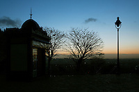 Skyline from Montmartre, Paris, France. A general view across the park around Sacré-Coeur Basilica showing the Paris skyline on a winter morning, with a lamp-post, tree and shelter silhouetted in the foreground. Picture by Manuel Cohen