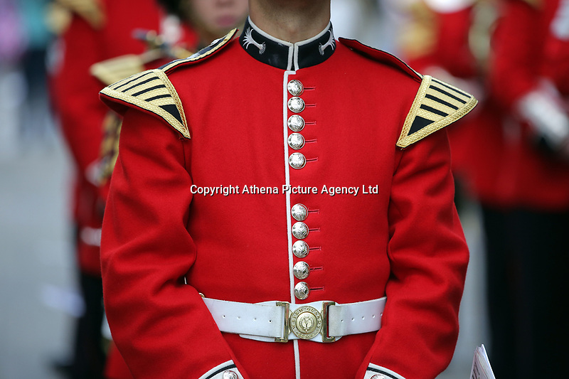 Pictured: The bright red tunic worn by a Welsh Guard as he parades through Castle Square in Swansea.  Friday 15 September 2017<br />Re: Soldiers from the Welsh Guards have exercised their freedom to march through the streets of Swansea in Wales, UK.<br />The Welsh warriors paraded with bayonets-fixed from the city centre to the Brangwyn Hall, where the Lord Mayor of Swansea took a salute.