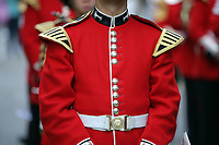 Pictured: The bright red tunic worn by a Welsh Guard as he parades through Castle Square in Swansea.  Friday 15 September 2017<br />