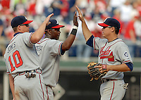 Atlanta Braves players Chipper Jones, left, Edgar Renteria, center, and Kelly Johnson, right, celebrate their 5-3 victory over the Philadelphia on opening day Monday, April 2, 2007, in Philadelphia. Renteria hit two home runs on the day. (Bradley C Bower/Bloomberg News)