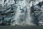 A glacier calving into the sea, Alaska