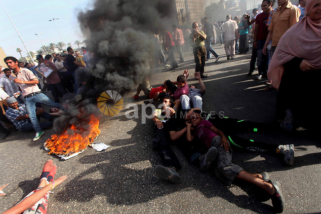 Egyptian anti-Mubarak protesters gather in Cairo's Tahrir square on June 02, 2012. Egypt's Muslim Brotherhood called for mass protests after a court sentenced ousted President Hosni Mubarak and his interior minister to life in prison but acquitted six security chiefs in the deaths of protesters last year. Photo by Ashraf Amra