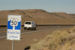 US 50-Loneliest Highway in US sign at Churchill-Lander County line, central Nevada.
