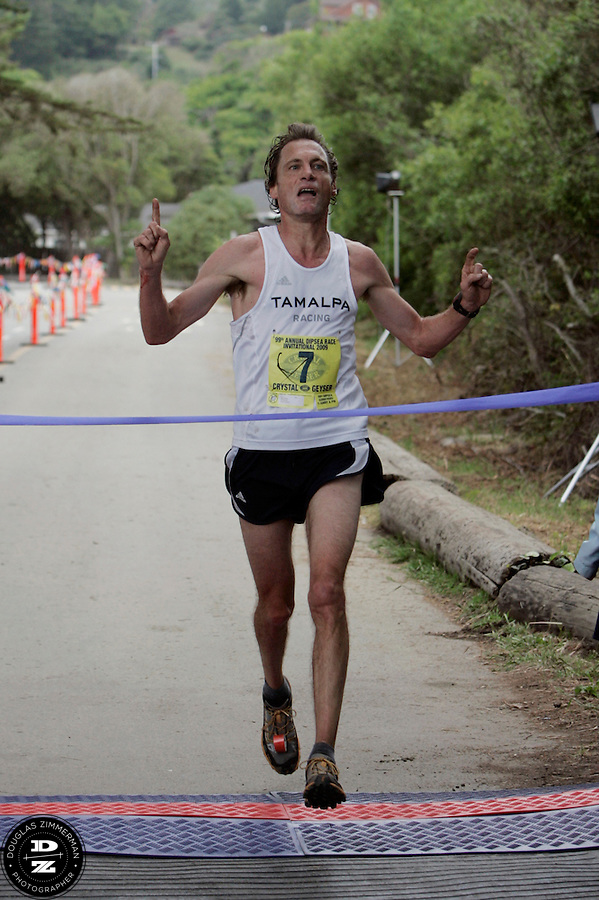 Brian Pilcher (7) crosses the finish line in first place at the 99th running of the Dipsea Race at Sintson Beach State Park on Sunday June 14th, 2009.