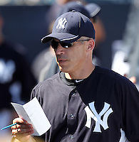 New York Yankees manager Joe Girardi #28 making changes in the dugout during a scrimmage against the USF Bulls at Steinbrenner Field on March 2, 2012 in Tampa, Florida.  New York defeated South Florida 11-0.  (Mike Janes/Four Seam Images)