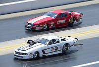 Apr. 14, 2012; Concord, NC, USA: NHRA pro mod driver Mike Janis (near lane) races alongside Don Walsh Jr during qualifying for the Four Wide Nationals at zMax Dragway. Mandatory Credit: Mark J. Rebilas-