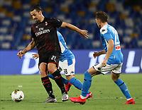 12th July 2020; Stadio San Paolo, Naples, Campania, Italy; Serie A Football, Napoli versus AC Milan; Zlatan Ibrahimovic of AC Milan holds off Stanislav Lobotka of Napoli