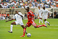 Atiba Hutchinson (13)of Canada (CAN) shoots as Nery Medina (16) of Honduras (HON) defends during a quarterfinal match of the CONCACAF Gold Cup at Lincoln Financial Field in Philadelphia, PA, on July 18, 2009.