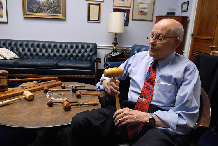 Rep. John Dingell, D-Mich., poses with his gavel collection.
