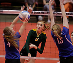 RAPID CITY, SD: NOVEMBER 18:  Riley Grandpre #5 of Northwester hits over Warner blockers Sydney Leidholt #4 and Laurie Rogers #13 during the 2017 South Dakota State Class B Volleyball Championship Saturday evening at Barnett Arena in Rapid City, S.D.   (Photo by Dick Carlson/Inertia)