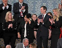 Alice Johnson who had been serving a mandatory life sentence without parole for charges associated with a nonviolent drug case, wipes a tear as she is introduced by United States President Donald J. Trump during his second annual State of the Union Address to a joint session of the US Congress in the US Capitol in Washington, DC on Tuesday, February 5, 2019.  Johnson, who's case was brought to the President's attention by actress Kim Kardashian and Senior Advisor Jared Kushner, right, was granted clemency on June 6, 2018. First Daughter and Advisor to the President Ivanka Trump applauds at far right.<br /> Credit: Alex Edelman / CNP/AdMedia