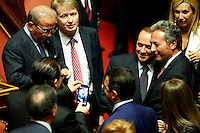 Il leader del PdL Silvio Berlusconi si lascia fotografare con alcuni senatori durante la discussione sulla mozione di sfiducia nei confronti del Ministro dell'Interno e Vicepresidente del Consiglio al Senato, Roma, 19 luglio 2013.<br /> People of Freedom (PdL) party's leader Silvio Berlusconi, second from right, takes pictures with some senators during a plenary session for the discussion of a no confidence motion against Interior Minister and Deputy Premier, at the Senate in Rome, 19 July 2013.<br /> UPDATE IMAGES PRESS/Riccardo De Luca