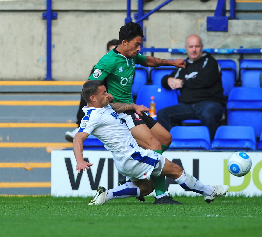 Lincoln City's Macauley Bonne vies for possession with Tranmere Rovers' Lee Vaughan<br /> <br /> Photographer Andrew Vaughan/CameraSport<br /> <br /> Vanarama National League - Tranmere Rovers v Lincoln City - Saturday 10th September 2016 - Prenton Park - Birkenhead<br /> <br /> World Copyright &copy; 2016 CameraSport. All rights reserved. 43 Linden Ave. Countesthorpe. Leicester. England. LE8 5PG - Tel: +44 (0) 116 277 4147 - admin@camerasport.com - www.camerasport.com