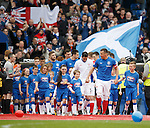 Rangers captain Lee McCulloch leads out the teams and mascots