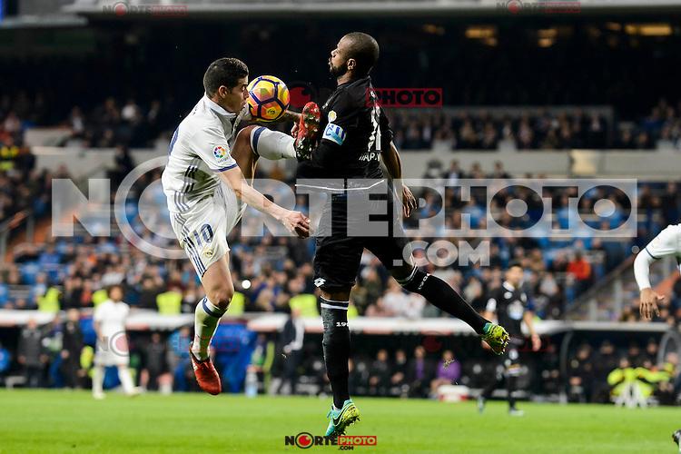 Real Madrid James Rodriguez and Deportivo de la Coruña Sidnei Rechel during La Liga match between Real Madrid and Deportivo de la Coruña at Santiago Bernabeu Stadium in Madrid, Spain. December 10, 2016. (ALTERPHOTOS/BorjaB.Hojas) /NORTEPHOTO.COM