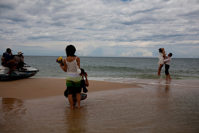 A couple have their wedding pictures taken on Mui Ne beach.