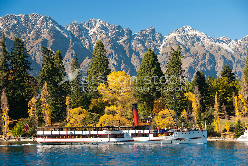 The TSS Earnslaw sails past Queenstown Gardens and the Remarkables Mountains, Central Otago, South Island, New Zealand.